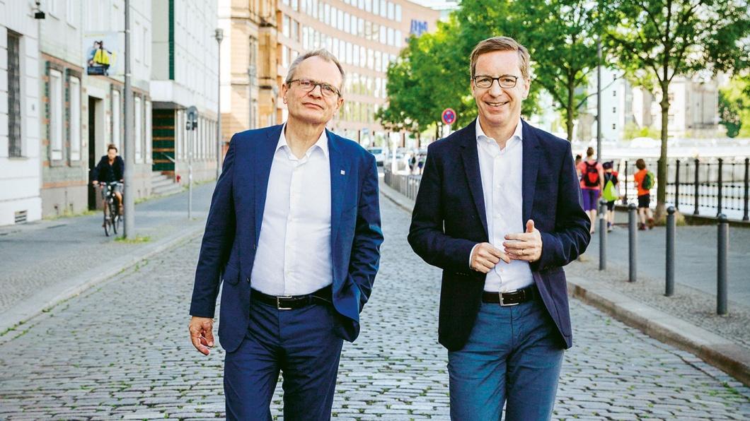 Michael Hüther (IW Köln) und Ulrich Lilie (Diakonie) im Gespräch in Berlin
