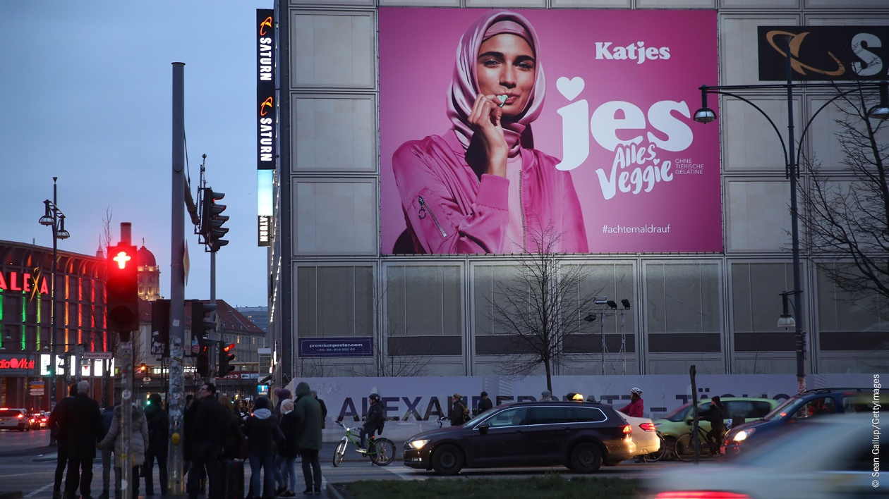 An advertisement for a new line of vegetarian sweets by German candymaker Katjes features a Muslim woman wearing a headscarf at Alexanderplatz on February 2, 2018 in Berlin, Germany.