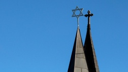 Side by side spires with cross and star of david