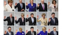 Die Mitglieder des neuen Bundeskabinetts werden im Bundestag vereidigt.