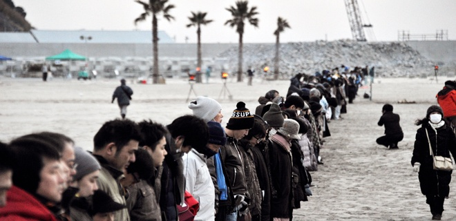 People Pray For Victims And Reconstruction At Beach In Iwaki
