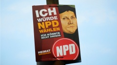 Wahlplakat der NPD mit einem Portraet des Reformators Martin Luther .