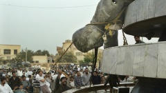 IRAQI CITIZENS HIT A PULLED DOWN A STATUE OF SADAM IN THE TOWN OF KARBALA.
