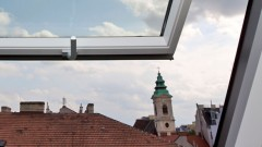 Dachwohnung mit Blick auf den Kirchturm - die Zukunft für Pfarrerinnen und Pfarrer?