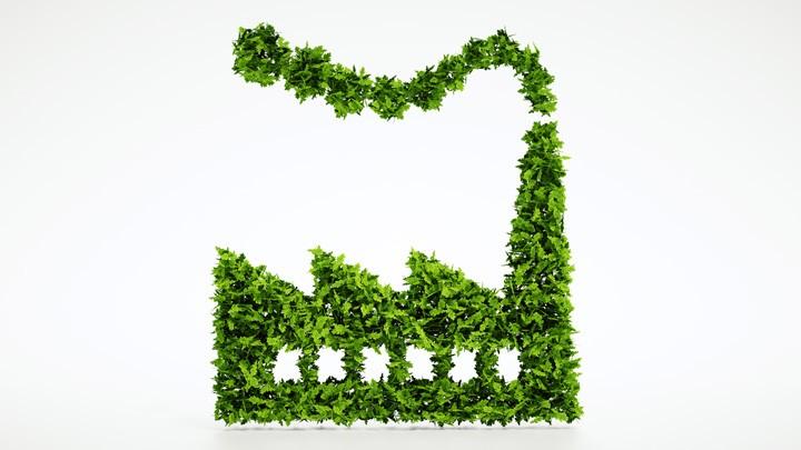 Symbolfoto Nachhaltigkeit und Klimaschutz: Grüne Blätter formen einen Fabrikgebäude.
